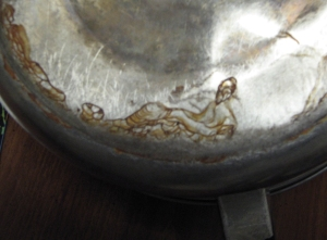 It looks like an oriental man reclining to me; perhaps an oriental Jesus?